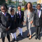All Saints Catholic School head of Year 7Meral Incedalwith pupils
