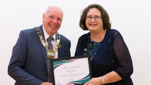Roy Brame presents an award toDerehamCommunity Crafters