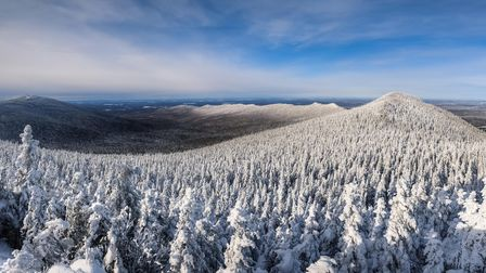 End of a cold winter afternoon over Megantic mountains range after the snowstorm, Quebec, Canada