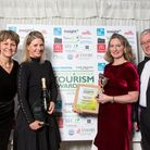 The team from the National Horse Racing Museum being presented with the Small Visitor Attraction Award