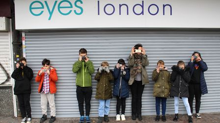 Some of theyouth theatre members snapping street scenes for Half Moon's 30th anniversary