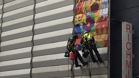 How artists steeplejack up the side of the arts centre creating the mural, as theydid in2020