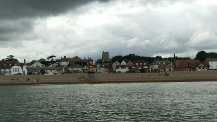 Aldeburgh from the sea with storm clouds above it