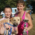 Ella Stanier (L) and her dog, Toby, pictured with mum, Kelly. Toby won 'best of show' at the Coates fete on September 18.
