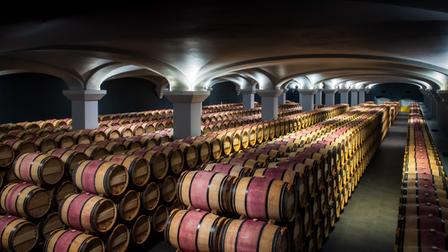 Wine barrels in the cellar at Château Margaux