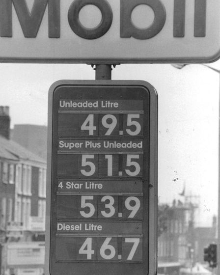 A Norfolk petrol pump displays some rather cheap fuel prices in 1992.