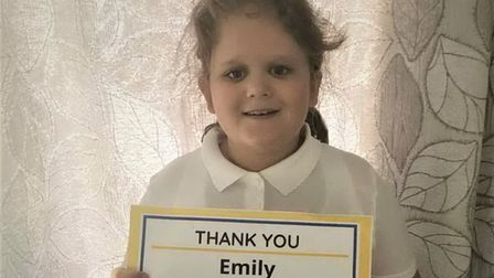 Emily Frear with her fundraising amount for Addenbrooke's Charitable Trust