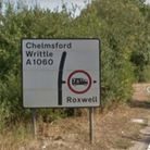 A Google Earth screencapture of a sign: Chelmsford, Writtle, A1060 and Roxwell
