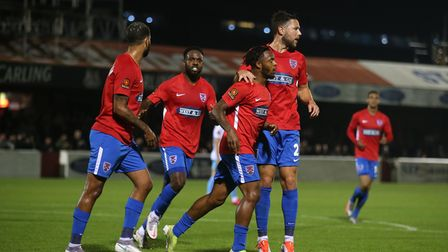 Mauro Vilhete of Dagenham and Redbridge scores the first goal for his team and celebrates with his t