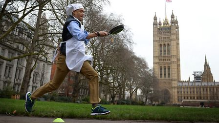 Norwich South MP Clive Lewis takes part the annual Rehab Parliamentary Pancake Race in which MPs, Lo