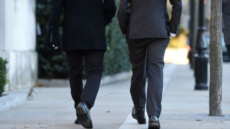 File photo dated 29/11/16 of men walking near St Paul's Cathedral, London, as a study has found that