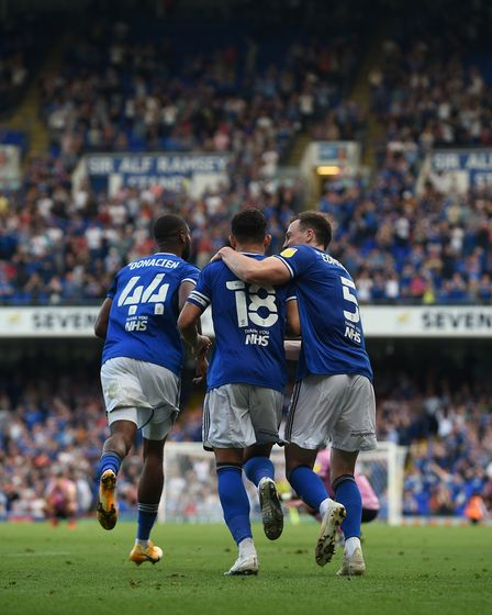 Macauley Bonne is congratulated after he stole the ball from the keeper to set up Ipswich's equalise