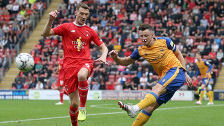Craig Clay of Leyton Orient and Ollie Clarke of Mansfield Town during Leyton Orient vs Mansfield Tow