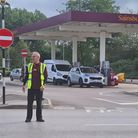 Stewarding the flow of cars for fuel at Sainsbury's, Ely