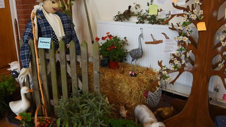 A farmer scarecrow at the Stowmarket United Reform Church's Scarecrow Harvest Festival to thank keyw