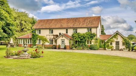 Pretty farmhouse with gardens and fountain in Stow Bedon, near Thetford Forest, which is for sale for £1.45m