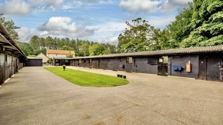 Row of well-kept stables at this equestrian property in Stow Bedon, Norfolk, which is for sale for £1.45m