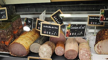 A selection of French meats, one labelled Andouille de Vire