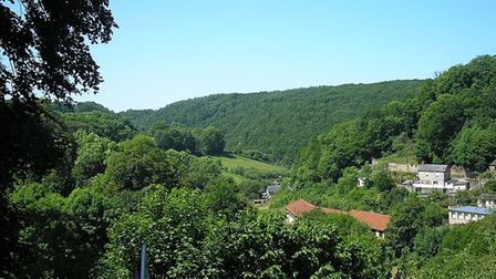 Houses in the Vire countryside of Normandy surrounded by forests