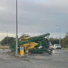 An overturned piece of farm machinery is causing delays near Bury St Edmunds