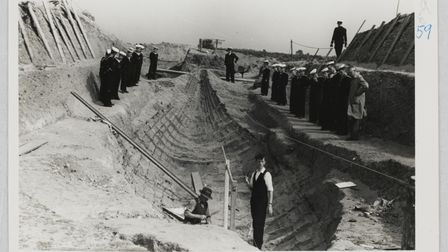 A group of naval cadets visit the site and view the excavation