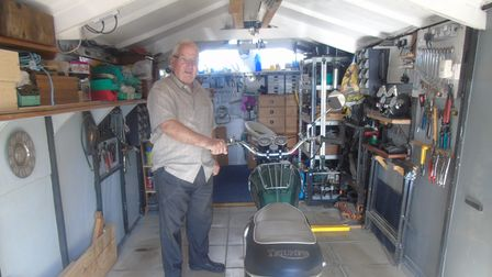 Philip Curson, from Dereham, in his workshop with one of his restored classic motorcycles