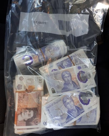 Police found cash totalling around £15,000 and 100 wraps of Class A drugs following a search of a car stopped in Newmarket.