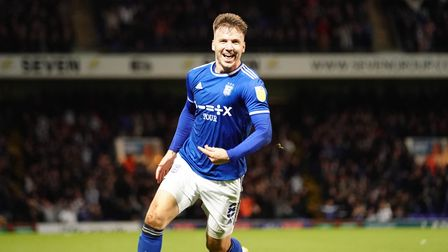 Lee Evans celebrates after scoring Towns fifth.