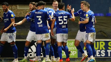 Town players celebrate with Lee Evans after he had scored to take them 2-0 up.