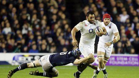 England's Billy Vunipola breaks through the Scotland line during the 2016 RBS Six Nations match at B