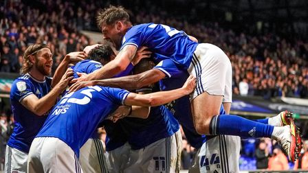 Town players celebrate with a hidden Lee Evans after his hat-trick in the Ipswich Town v Doncaster Rovers match