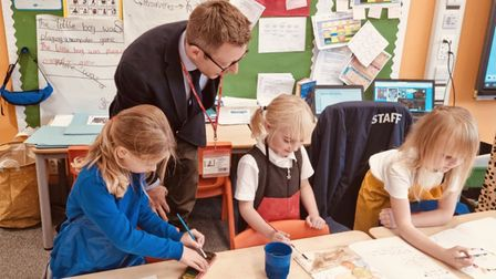Pupils from Astley Primary, in Melton Constable, showing North Norfolk MP Duncan Baker their work