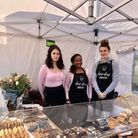 Sacha Beales (centre) owner of Drip Drop Bake Stop, along with the staff at the stall.