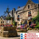 Cobblestone town square with flowers in Rochefort en Terre in Brittany