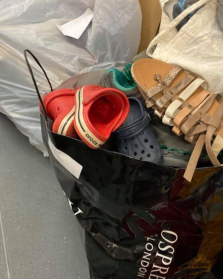 Childrens\' shoes, donated by residents, at a storage facility in Essex