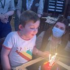 Alec pictured celebrating his fifth birthday, a milestone doctors feared he would never make