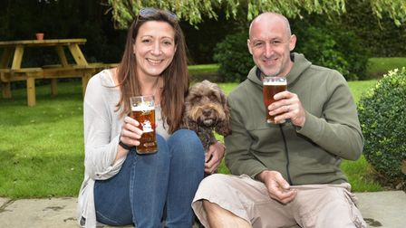 Celebrating The Bell in Brisley's Best Pub Garden award. Tom and Sue Daynes with cockerpoo, Ernie. B