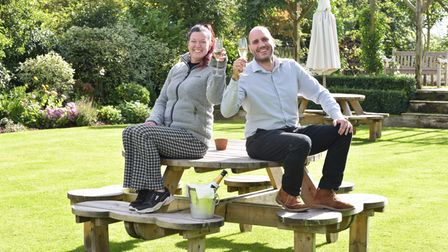 Celebrating The Bell in Brisley's Best Pub Garden award.Yeray Sanchez, front of house manager and O