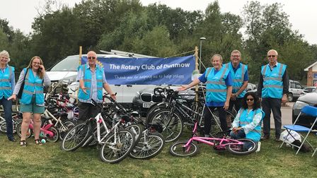 Volunteers from the Rotary Club of Dunmow with a stash of bicycles