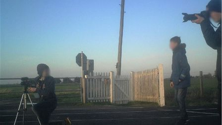 Children taking photos on a rail line at March is being used as part of a nationwide safety campaign.