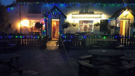 The Wortwell Bell pub at night decorated with Christmas lights