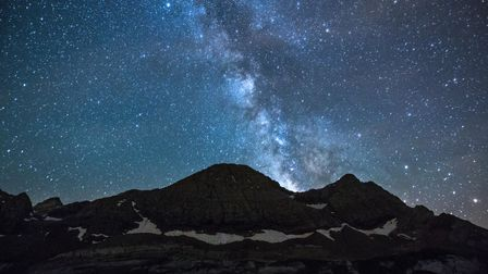 A starry sky at night above the mountains of Occitanie