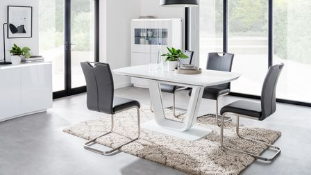 The modern Lazzaro dining collection from Aldiss featuresglass top tables in white or grey with grey chairs
