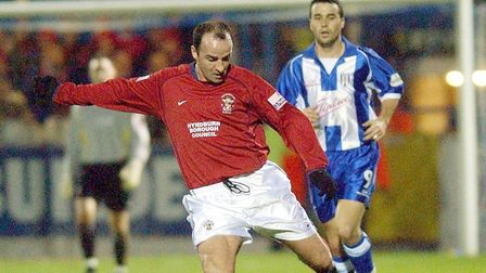 Accrington Stanley Paul Cook on the ball with Colchesters Scott McGleish closing, during their FA Cu