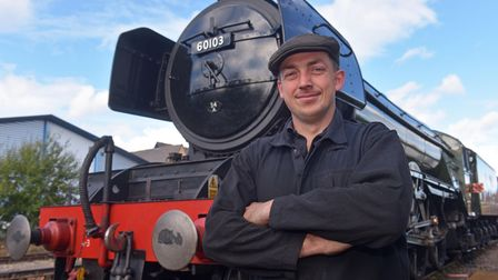 Mid Norfolk Railway driver James Francis-Beck pictured in front of Flying Scotsman at Dereham station