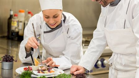 Chefs working in a French restaurant (c) nicexray Getty Images