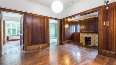 Huge wood panelled reception hall in an Edwardian home in Norwich which sold at auction