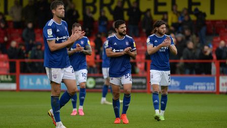 Disappointed Ipswich players trudge of the pitch at Accrington Stanley.