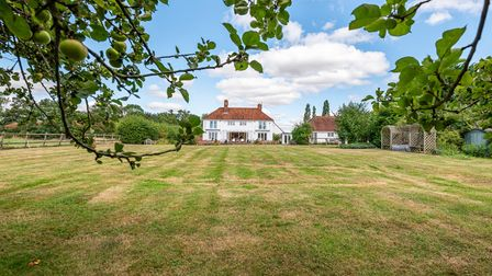 To the rear of the property is a delightful, spacious yet low-maintenance lawn garden