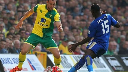 Steven Whittaker of Norwich and Jeff Schlupp of Leicester City ]in action during the Barclays Premie